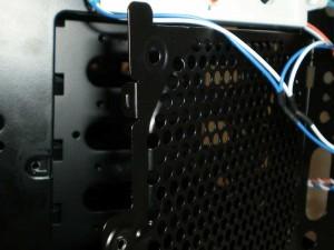 Front fan door sits ajar when thumbscrew is removed.