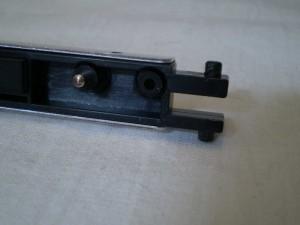 Close up of ODD mounting door, detailing locking pins and door hinge