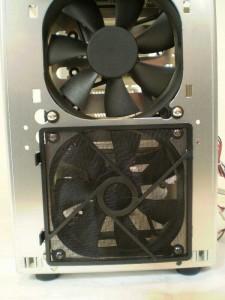 One fan grill removed, note the rubber grommets to dampen fan noise