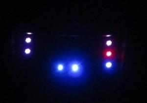 Power / Reset / Fan controller panel in the dark.
