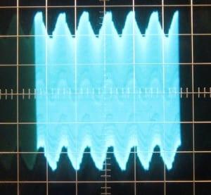 12 V rail, ~59 mV of ripple. Scope at 10mV/div and 10ms/div