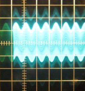 3.3 V rail, ~64 mV of ripple. Scope at 10mV/div and 10μs/div