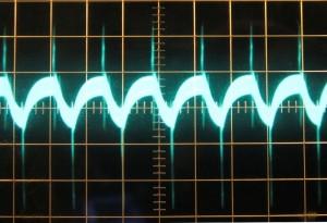 5 V rail, ~49 mV of ripple. Scope at 10mv/div and 10μs/div